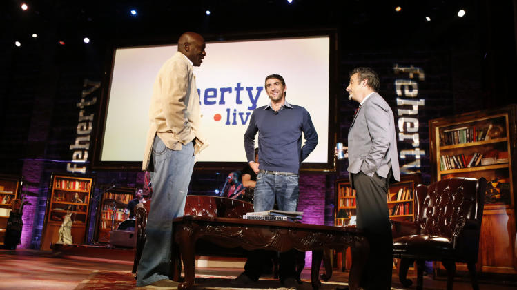 (L-R) Michael Jordan, Michael Phelps and David Feherty are seen at Golf Channel's 'Feherty Live From the Ryder Cup', on Monday, September 24, 2012 at the Tivoli Theatre in Downers Grove, IL.  (Ross Dettman /AP Images for Golf Channel)