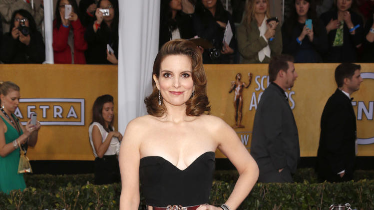Tina Fey arrives at the 19th Annual Screen Actors Guild Awards at the Shrine Auditorium in Los Angeles on Sunday Jan. 27, 2013. (Photo by Todd Williamson/Invision for The Hollywood Reporter/AP Images)