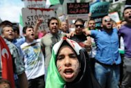 Demonstrators protest against Syrian President Bashar al-Assad in front of the Syrian consulate in Istanbul on May 27. The UN&#39;s top observer said on Wednesday he was &quot;deeply disturbed&quot; by a newly discovered massacre in Syria, as the opposition insisted President Bashar al-Assad must step down if a peace plan is to be saved