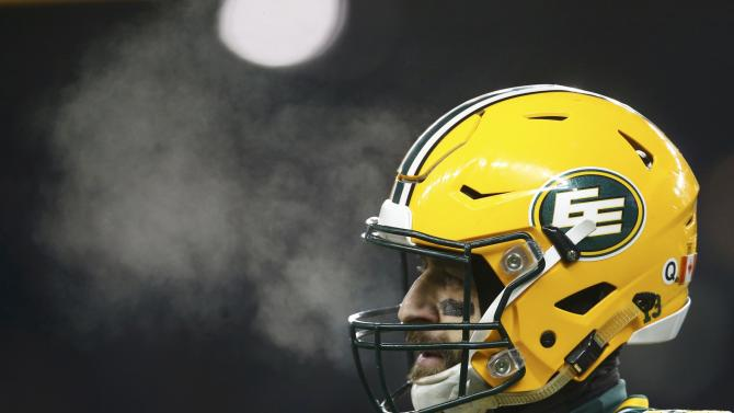 Edmonton Eskimos quarterback Mike Reilly pauses during the CFL's 103rd Grey Cup championship football game against the Ottawa Redblacks in Winnipeg