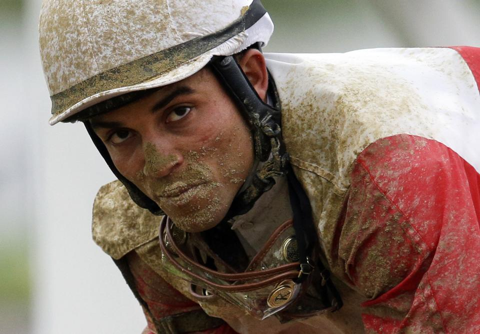 Jockey Joel Rosario gallops orb back to the paddock after the 138th Preakness Stakes horse race at Pimlico Race Course, Saturday, May 18, 2013, in Baltimore. Oxbow won the race. Orb, the Kentucky Derby winner, finished fourth. (AP Photo/Patrick Semansky)