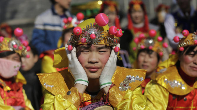 Performers wait for their turn to go onto the stage at the Longtan park as the Chinese Lunar New Year, which welcomes the Year of the Monkey, is celebrated in Beijing
