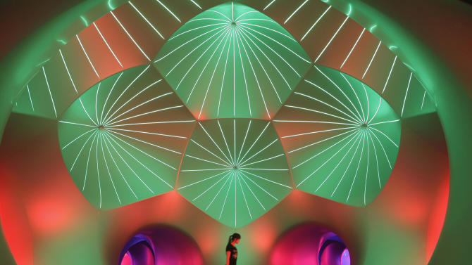 A site coordinator walks past a Luminarium installation by designer Parkinson during a Britain Arts Festival in Wuhan
