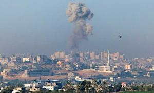 A plume of smoke rises over Gaza during an Israeli air strike, as seen from Sderot in Israel.