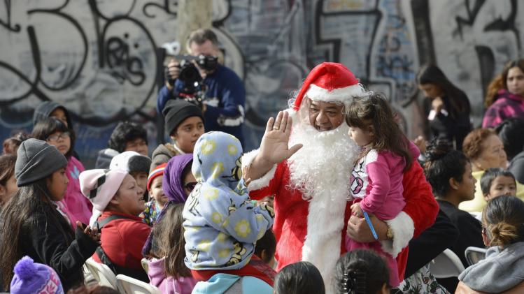 Holiday gifts and toys are distributed to underprivileged children at the Fred Jordan Mission in Los Angeles