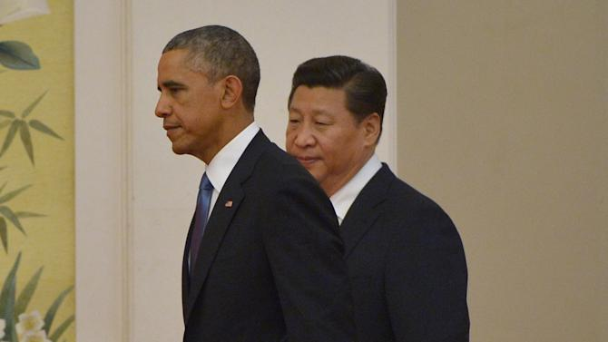 US President Barack Obama (L) and China's President Xi Jinping arrive for a press conference at the Great Hall of the People in Beijing on November 12, 2014