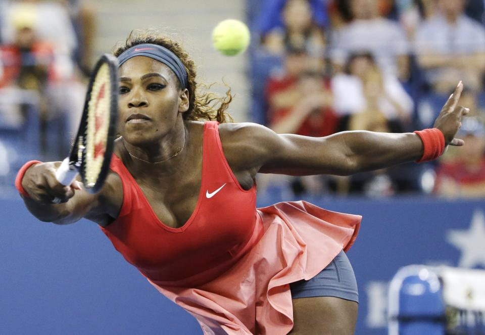 Serena Williams returns a shot to Victoria Azarenka, of Belarus, during the women's singles final of the 2013 U.S. Open tennis tournament, Sunday, Sept. 8, 2013, in New York. (AP Photo/David Goldman)