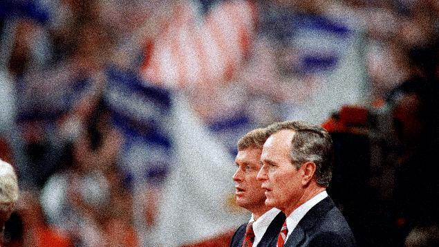 FILE - In this Aug. 18, 1988 file photo, Republican presidential candidate George H.W. Bush and his running mate Sen. Dan Quayle, R-Ind.,  stand together during the final night of the Republican National Convention in New Orleans. Mitt Romney did not mention the war in Afghanistan, where 79,000 US troops are fighting, in his speech accepting the Republican presidential nomination on Thursday. The last time a Republican presidential nominee did not address war was 1952, when Dwight Eisenhower spoke generally about American power and spreading freedom around the world but did not explicitly mention armed conflict. Below are examples of how other Republican nominees have addressed the issue over the years, both in peacetime and in war.   (AP Photo/Bob Daugherty, File)