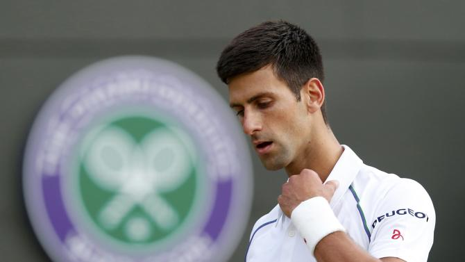 Novak Djokovic of Serbia reacts during his match against Kevin Anderson of South Africa at the Wimbledon Tennis Championships in London