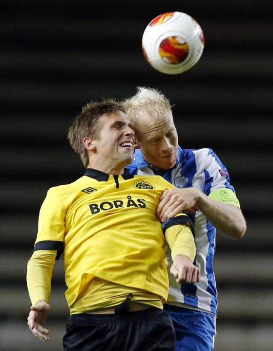 Elfsborg's Anders Svensson and Esbjerg's Hans Henrik Andreasen vie for the ball during the group C UEFA Europa League match IF Elfsborg vs Esbjerg fB at the Boras Arena in Boras, Sweden, Thursday Oct.