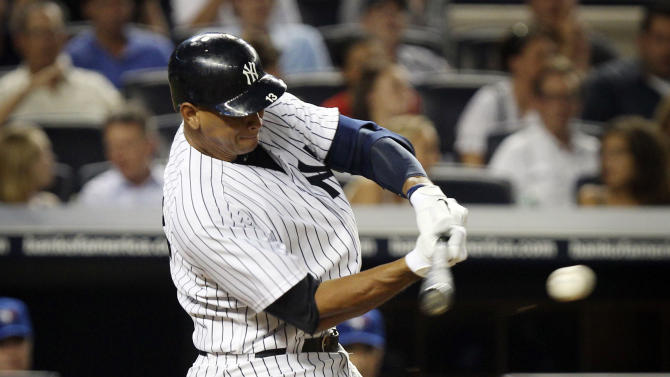 New York Yankees' Alex Rodriguez drives in a run and reaches second base on a fielder's choice during the seventh inning of a baseball game against the Toronto Blue Jays, Tuesday, July 17, 2012, at Yankee Stadium in New York. (AP Photo/Seth Wenig)