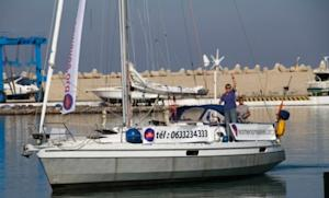 """""""Women on Waves"""" advertises a hotline for safe abortions as it sails around a port in northern Morocco on Oct. 4."""