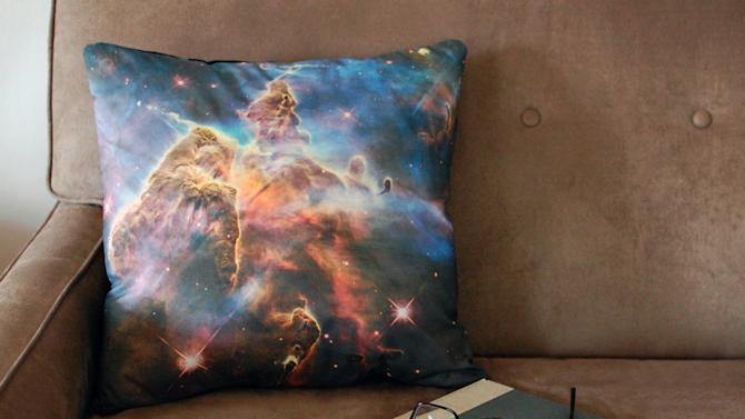 This image taken on November 6, 2012 provided by Pillars of Creation shows a galaxy pillow cover (www.etsy.com/shop/pillarsofcreation) printed with an image from the Hubble telescope in Portland, Oregon. (AP Photo/Pillars of Creation, Rachel Jacks)