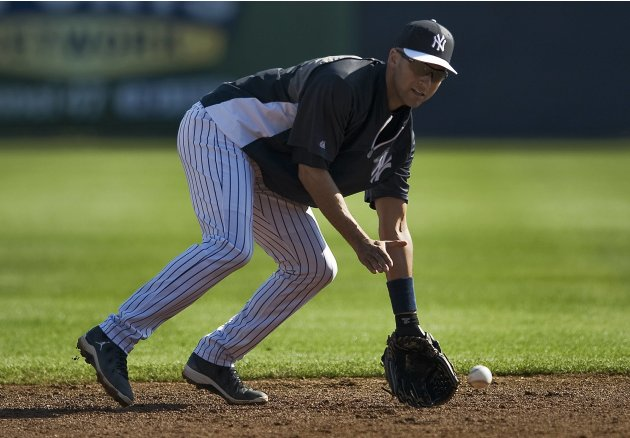New York Yankees shortstop Jeter reaches for a ground ball during a workout before a MLB spring training baseball game with the Florida Marlins in Tampa, Florida