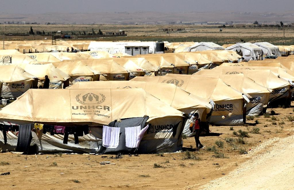 Bomb kills 11 at Syria-Jordan border camp: monitor
