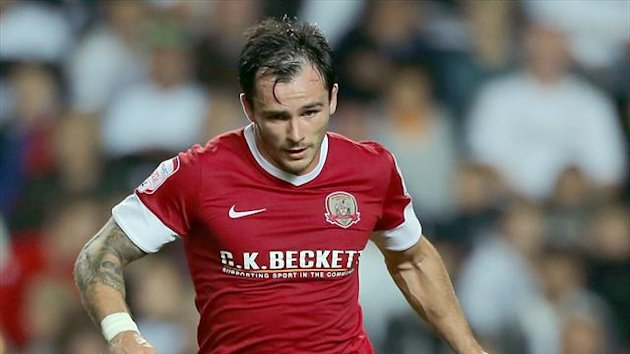 Chris Dagnall, pictured, and Jason Scotland were on target for relegation-threatened Barnsley