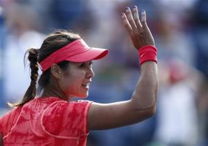Li Na of China waves after defeating Makarova of Russia at the U.S. Open tennis championships in New York