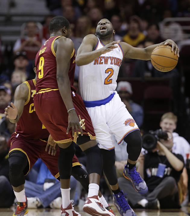 New York Knicks' Raymond Felton (2) drives past Cleveland Cavaliers' Luol Deng, (9) during the first quarter of an NBA basketball game Saturday, March 8, 2014, in Cleveland