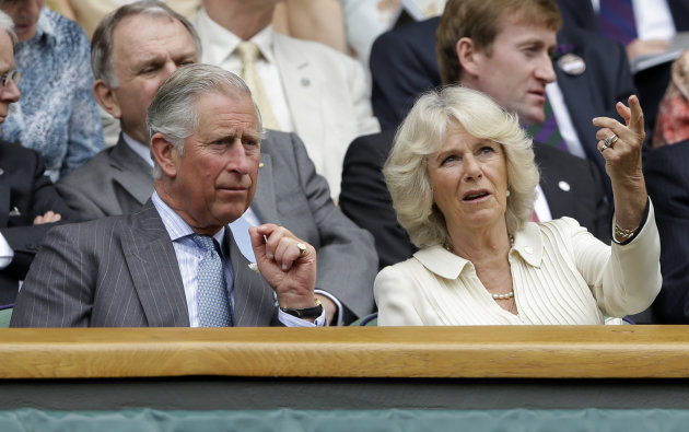 Britain&#39;s Prince Charles, left, and his wife Camilla, Duchess of Cornwall, wait in the Royal Box for the start of a second round men&#39;s singles between Roger Federer of Switzerland Fabio Fognini of Italy during a match at the All England Lawn Tennis Championships at Wimbledon, England, Wednesday, June 27, 2012. (AP Photo/Kirsty Wigglesworth)