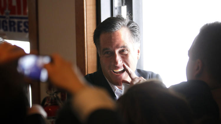 Republican presidential candidate, former Massachusetts Gov. Mitt Romney, greets audience members as he leaves the Ingham Lincoln Day Breakfast in Lansing, Mich., Saturday, Feb. 25, 2012. (AP Photo/Gerald Herbert)