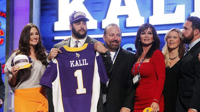 Southern California offensive lineman Matt Kalil poses for photographs with loved ones after being selected as the fourth pick overall by the Minnesota Vikings in the first round of the NFL football draft at Radio City Music Hall, Thursday, April 26, 2012, in New York. (AP Photo/Jason DeCrow)