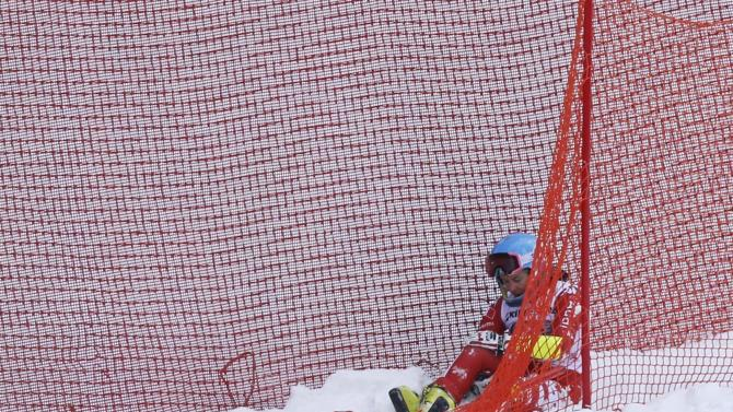 erighetti from Italy sits on the ground after crashing during the last women's downhill training run of the Alpine Skiing World Cup in Garmisch-Partenkirchen