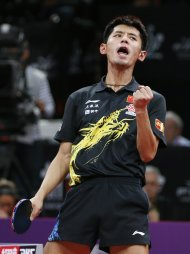 China&#39;s Zhang Jike reacts during his men&#39;s singles final at the World Team Table Tennis Championships in Paris May 20, 2013. Zhang Jike defeated his compatriot Wang Hao. REUTERS/Charles Platiau (FRANCE - Tags: SPORT TABLE TENNIS)