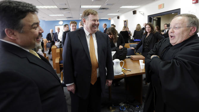 Attorney Rick Gray, center, representing more than 400 districts mostly in poorer areas of the state, talks with State District Judge John Dietz, right,  after he made his ruling in a consolidated six-lawsuit case contending the school finance system violates the Texas Constitution, Monday, Feb. 4, 2013, in Austin, Texas. Dietz ruled that he system Texas uses to fund public schools violates the state's constitution by not providing enough money to school districts and failing to distribute the money in a fair way. (AP Photo/Eric Gay)