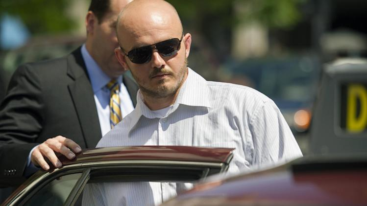 Former Blackwater Worldwide guard Nicholas Slatten enters a taxi cab as he leaves federal court in Washington, Wednesday, June 11, 2014, after the start of his first-degree murder trial. Slatten and three other Blackwater Worldwide guards are on trial for the killing of 14 Iraqi civilians and the wounding of 18 others in bloodshed that inflamed anti-American sentiment around the globe. (AP Photo/Cliff Owen)