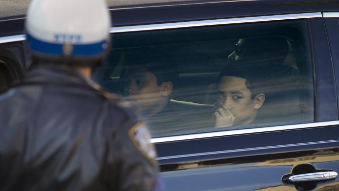 Jaden and Justin Ramos arrive in a limo for their father, NYPD officer Rafael Ramos' funeral at Christ Tabernacle Church to it's final resting place in the Queens borough of New York