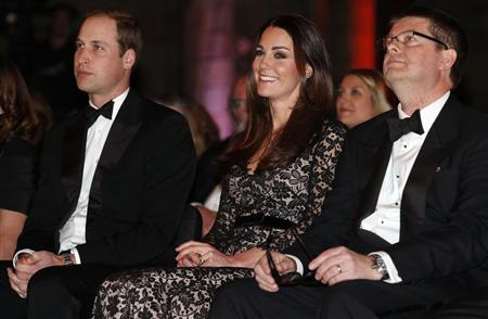 "Britain's Prince William and his wife Catherine, the Duchess of Cambridge, sit with Natural History Museum Director Dixon before a screening of ""David Attenborough's Natural History Museu"