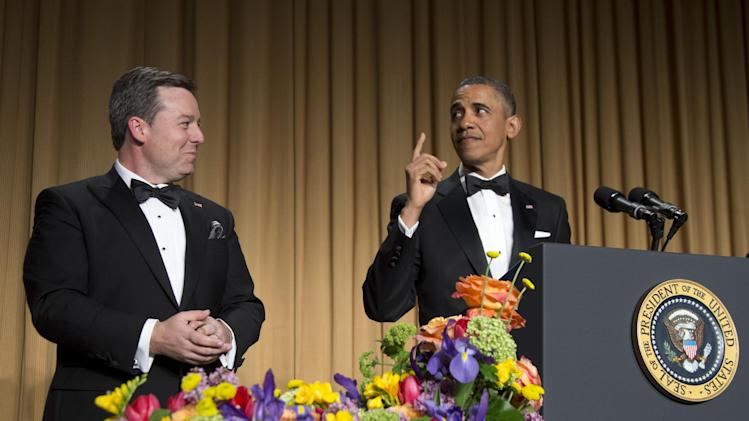 President Barack Obama looks to White House Correspondent Association President Ed Henry, Chief White House Correspondent for Fox News, as he speaks during the White House Correspondents' Association Dinner at the Washington Hilton Hotel, Saturday, April 27, 2013, in Washington.  (AP Photo/Carolyn Kaster)