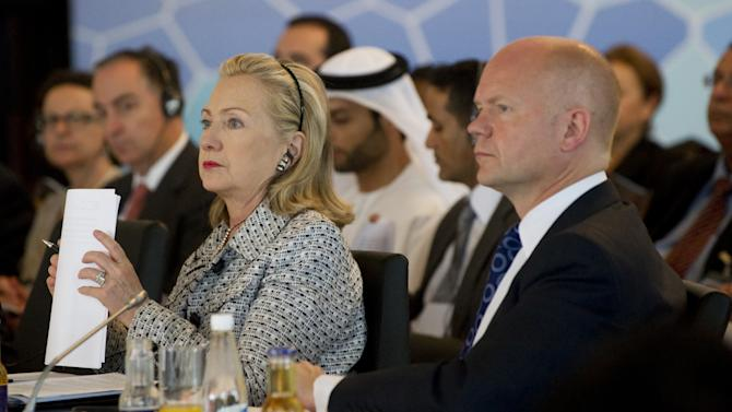 US Secretary of State Hillary Rodham Clinton sits alongside British Foreign Secretary William Hague during the fourth Libya Contact Group Meeting in Istanbul, Friday, July 15, 2011. Around 15 top diplomats including US Secretary of State Hillary Rodham Clinton are to meet in Istanbul to discuss a political solution to the conflict in Libya while co-ordinating aid for the rebels.  (AP Photo/Saul Loeb, Pool)