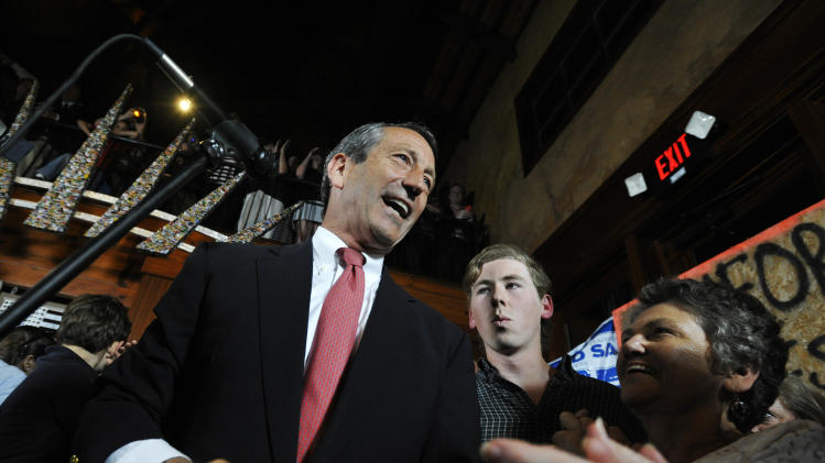 Former South Carolina Gov. Mark Sanford, left, gives his victory speech after winning back his old congressional seat in the state's 1st District on Tuesday, May 7, 2013, in Mt. Pleasant, S.C. (AP Photo/Rainier Ehrhardt)