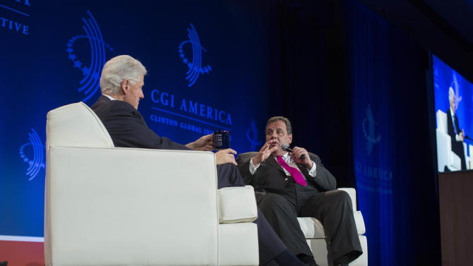 """New Jersey Gov. Chris Christie, right, speaks while former President Bill Clinton listens during the Clinton Global Initiative (CGI) Meeting in Chicago, Friday, June 14, 2013. Clinton and Christie held a closing session titled """"Cooperation and Collaboration: A Conversation on Leadership."""" (AP Photo/Scott Eisen)"""