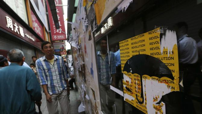 Sticker by pro-democracy protesters is seen at a bus stop as normal traffic resumes at the main Nathan Road in Hong Kong