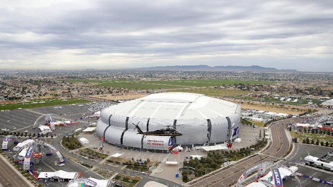 A U.S. Customs and Border Protection Black Hawk helicopter flies above University of Phoenix Stadium, site of Super Bowl XLIX football game, for a media security demonstration Monday, Jan. 26, 2015, in Glendale, Ariz.  The Black Hawk helicopters usually deployed along the U.S.-Mexico border have been brought to the Super Bowl venue to assist with the security effort