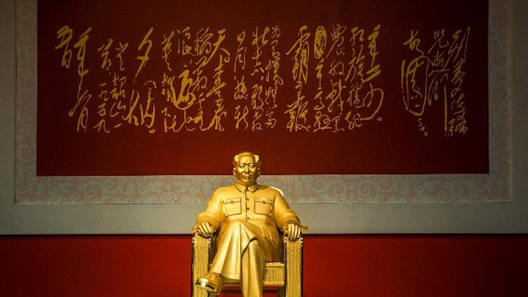 A gold and jade statue of Mao Zedong is displayed at an exhibition in Shenzhen, China's Guangdong province, on December 13, 2013