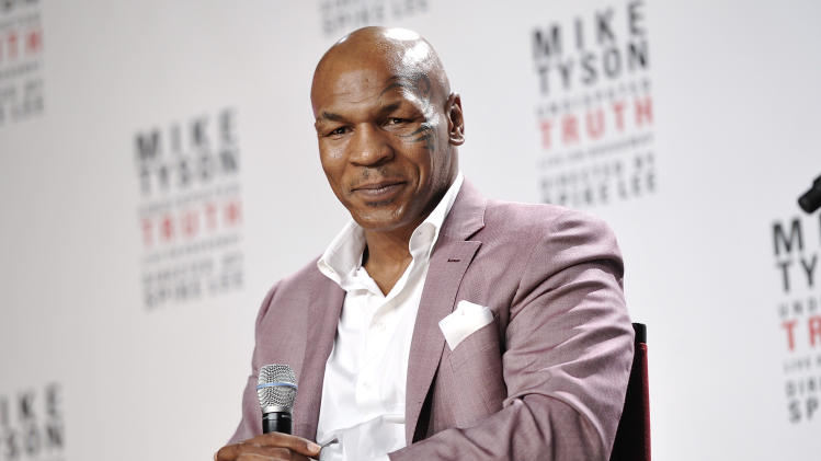 "In this June 18, 2012 file photo, former heavyweight boxer Mike Tyson announces ""Mike Tyson: Undisputed Truth"" a one man show on Broadway, in New York. Tyson and his wife sued SFX Financial Advisory Management Services, a subsidiary of Live Nation Entertainment on Wednesday Feb. 20, 2013 claiming a former employee of the financial services company embezzled more than $300,000 from them and cost them millions in lucrative contracts.(Photo by Evan Agostini/Invision/AP, File)"