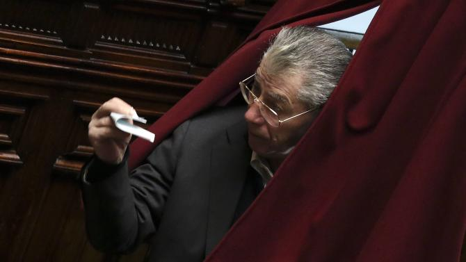Former Northern League leader Umberto Bossi casts his vote at the Chambers of Deputies in Rome