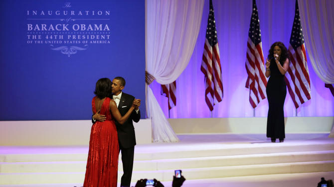 Jennifer Hudson, right, sings while President Barack Obama and first lady Michelle Obama dance at Commander-in-Chief's Inaugural Ball at the 57th Presidential Inauguration in Washington, Monday, Jan. 21, 2013. (AP Photo/Jacquelyn Martin)