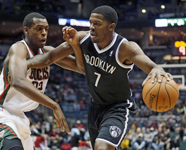 Brooklyn Nets' Joe Johnson tries to drive past Milwaukee Bucks' Khris Middleton during the first half of an NBA basketball game Saturday, Dec. 7, 2013, in Milwaukee