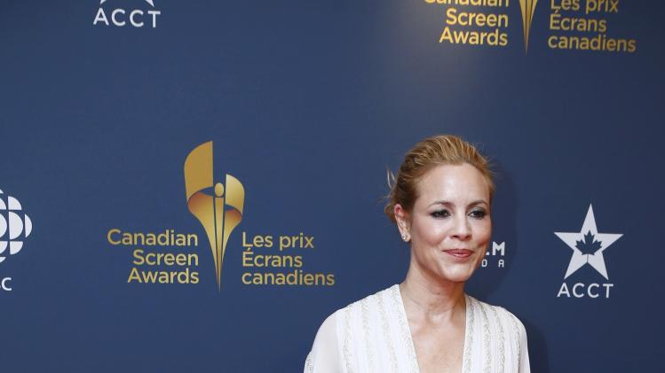 Actress Maria Bello arrives on the red carpet at the 2014 Canadian Screen awards in Toronto