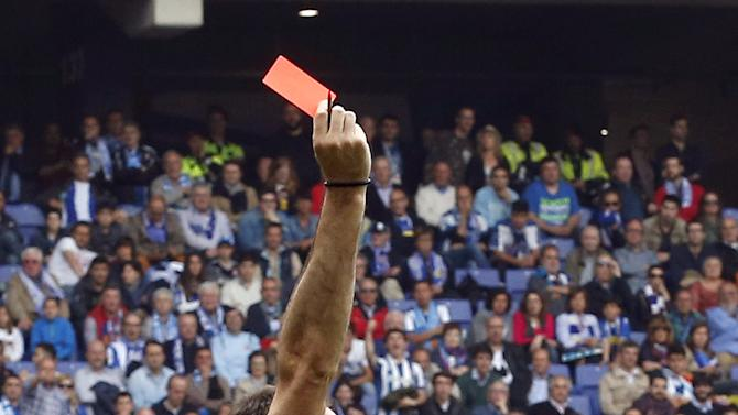 Referee Antonio Miguel Mateu shows the red card to Barcelona's Jordi Alba during their Spanish first division soccer match against Espanyol at Power8 stadium in Cornella de Llobregat near Barcelona