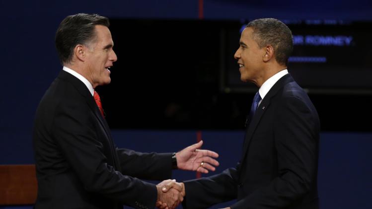 Republican presidential nominee Mitt Romney  and President Barack Obama  shake hands before the first presidential debate at the University of Denver, Wednesday, Oct. 3, 2012, in Denver. (AP Photo/Charlie Neibergall)