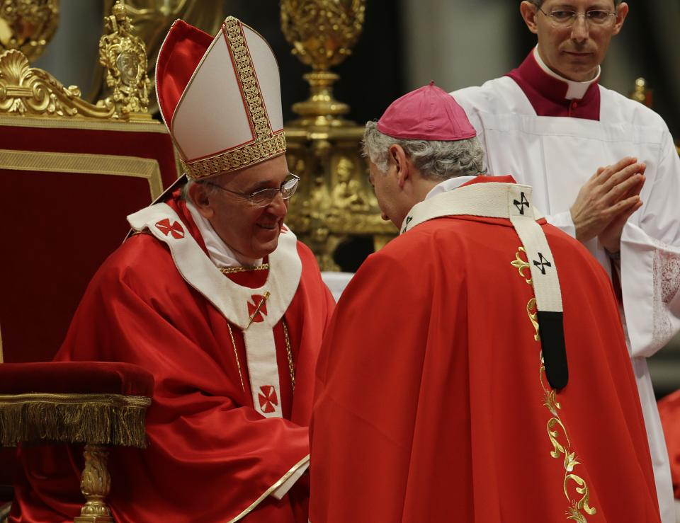 Monsignor Murray Chatlain, of Canada, is greeted by Pope Francis after receiving the Pallium, a woolen shawl symbolizing his bond to the pope, during a mass in St. Peter's Basilica, at the Vatican, Saturday, June 29, 2013. (AP Photo/Gregorio Borgia)