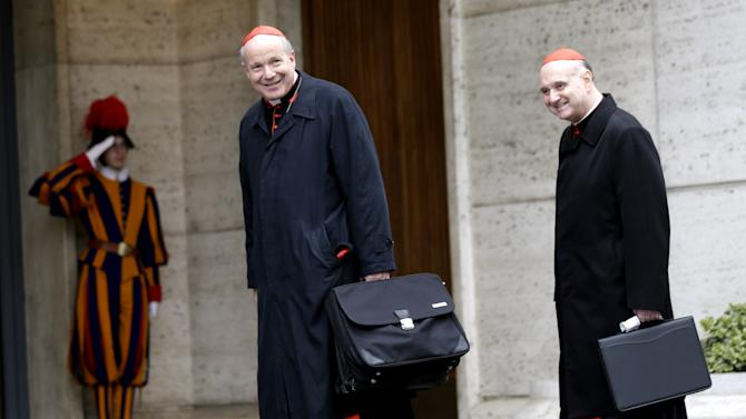 "Cardinal Christoph Schoenborn, center, and Cardinal Angelo Comastri  arrive for an afternoon meeting, at the Vatican, Friday, March 8, 2013. The Vatican says the conclave to elect a new pope will likely start in the first few days of next week. The Rev. Federico Lombardi told reporters that cardinals will vote Friday afternoon on the start date of the conclave but said it was ""likely"" they would choose Monday, Tuesday or Wednesday. The cardinals have been attending pre-conclave meetings to discuss the problems of the church and decide who among them is best suited to fix them as pope. (AP Photo/Alessandra Tarantino)"
