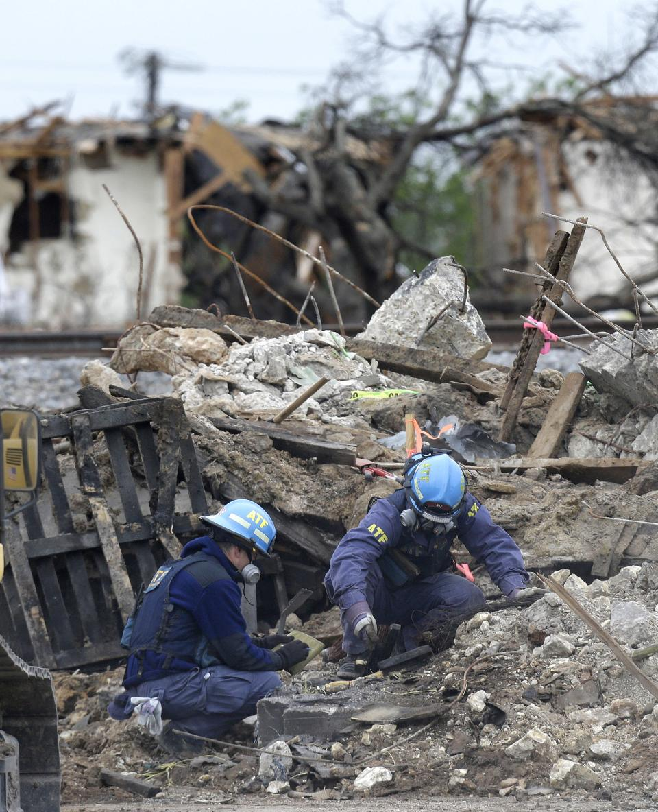 Investigators look through the debris of the destroyed fertilizer plant in West, Texas, Thursday, May 2, 2013. Investigators face a slew of challenges in figuring out what caused the explosion at the fertilizer plant that killed 14 people and destroyed part of the small Texas town. (AP Photo/LM Otero, Pool)