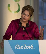 Brazilian President Dilma Rousseff gestures as she addresses a ceremony at Casa Brasil (Brazil House), in London on July 26, 2012,  on the eve of The London 2012 Olympic Games. AFP PHOTO/ Martin Bernetti