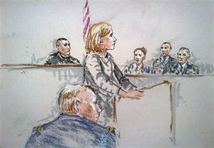 A courtroom sketch shows civilian attorney Emma Scanlan …